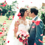 stock-photo-45296790-amazing-bride-and-groom-kissing-wedding-dress-flowers